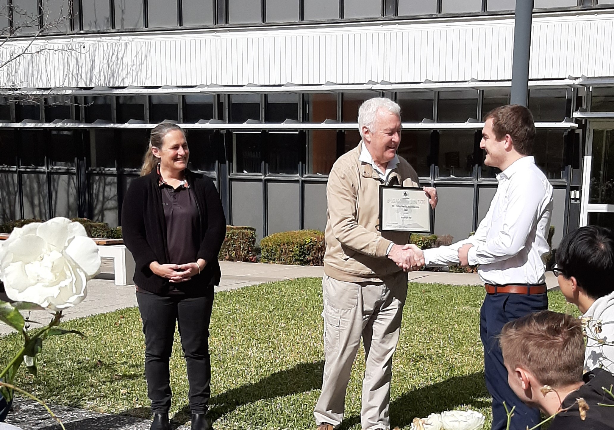 Matt St Hill receiving his award from Dr John Nevin and Dr Michelle Guppy in 2021